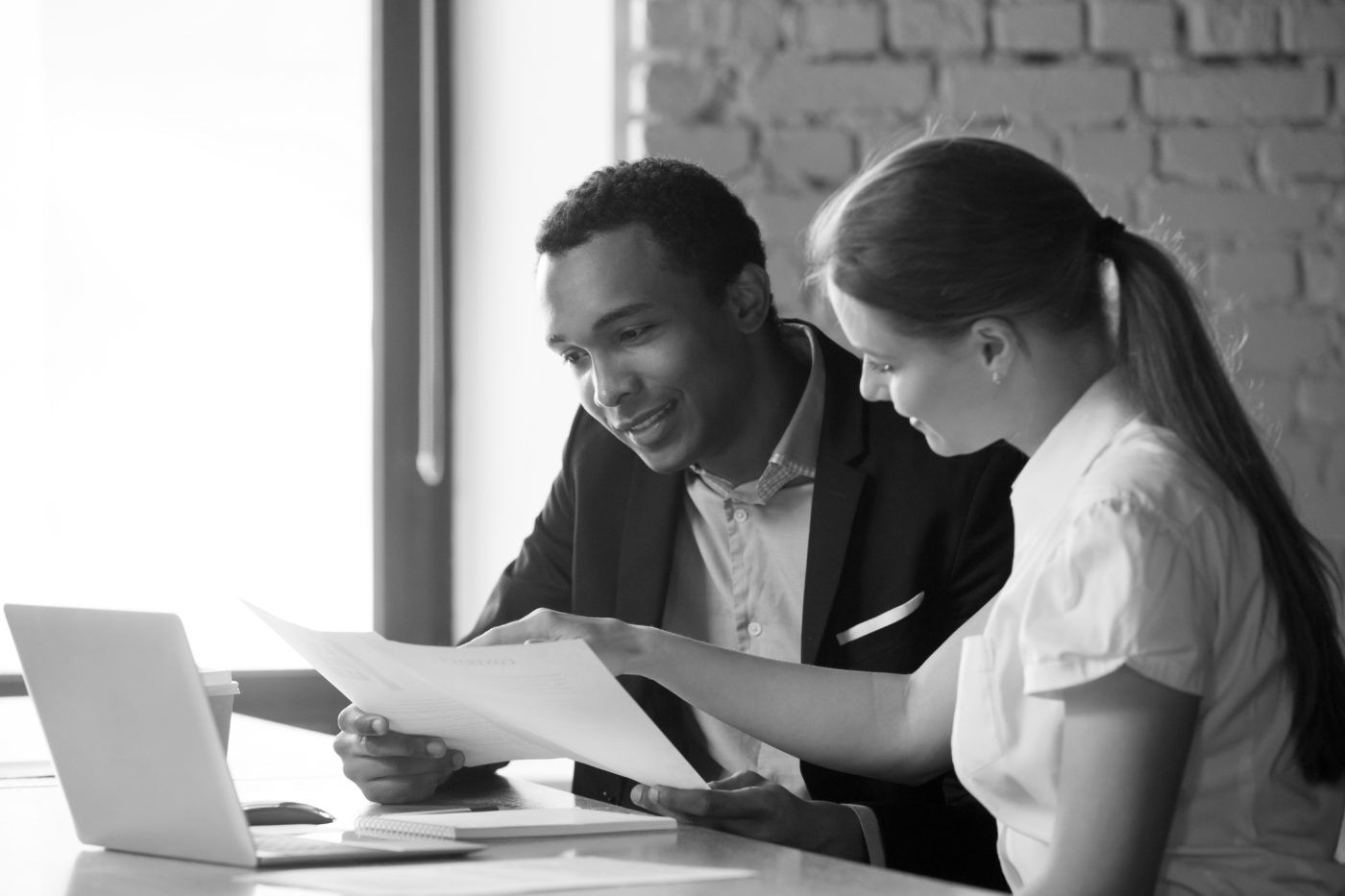 Female financial advisor insurer consulting male african-american client about contract
