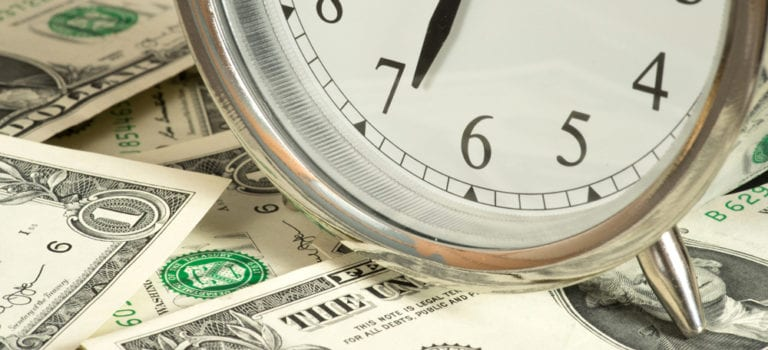 Image of a clock with money