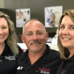 Bill Freeman, center, and his wife, Tracie, right, opened their third Badcock Home Furniture & more store this week in Elkin, N.C. Their daughter, Laura, left, will manage the new store.