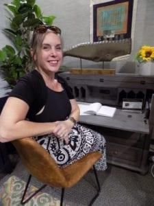 Shannon Gem shows a Twin Star Home desk at Las Vegas Market