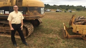 David Berggren stands on the ground where his fifth furniture store will be built in Clarksville, Tenn.