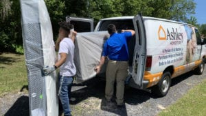 HFA members from Jacksonville's Ashley HomeStore deliver mattresses to families displaced by a fire earlier this year.