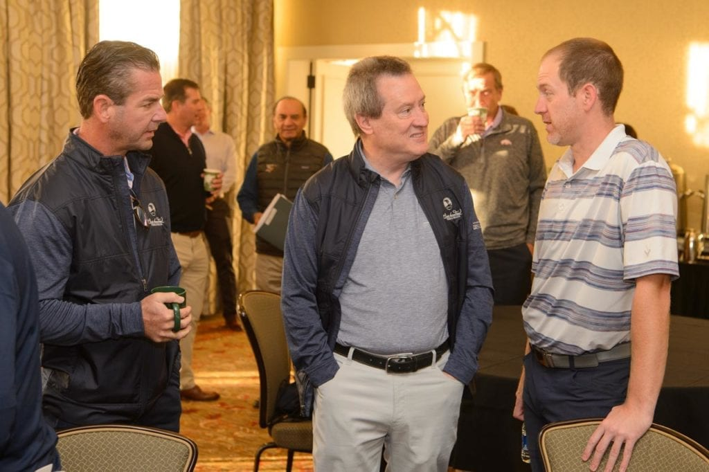 Photo shows Brian Woods, Oscar Miskelly and Trey Van Hoose at CEO Summit