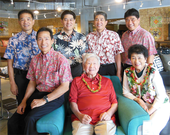 Photo shows Mr. Wo, his wife and five sons