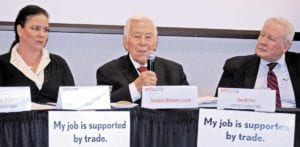 Photos shows people at trade forum